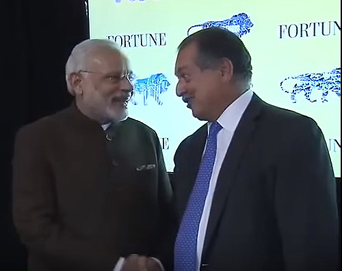 Narendra Modi and Andrew Liveris Shaking Hands
