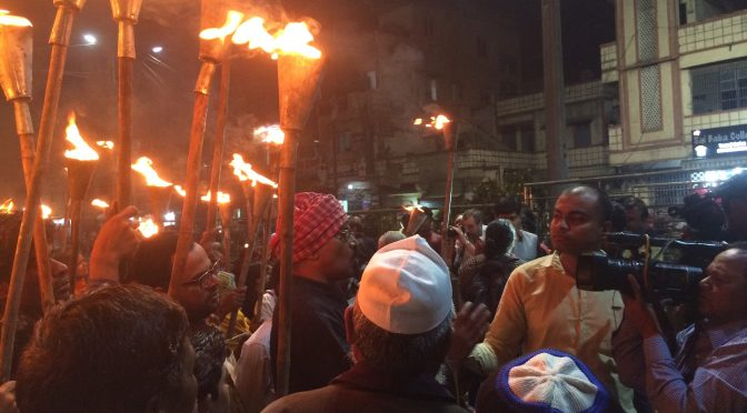 Survivors March with Flaming Torches to the Memorial Statue on the Occasion of 32nd Anniversary