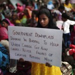 A child of a victim of the Bhopal gas tragedy holds a placard during a sit-in protest in New Delhi