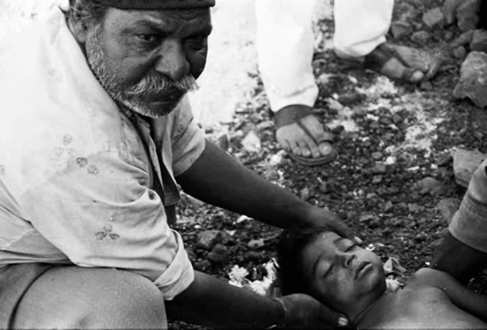 Man Burying Child